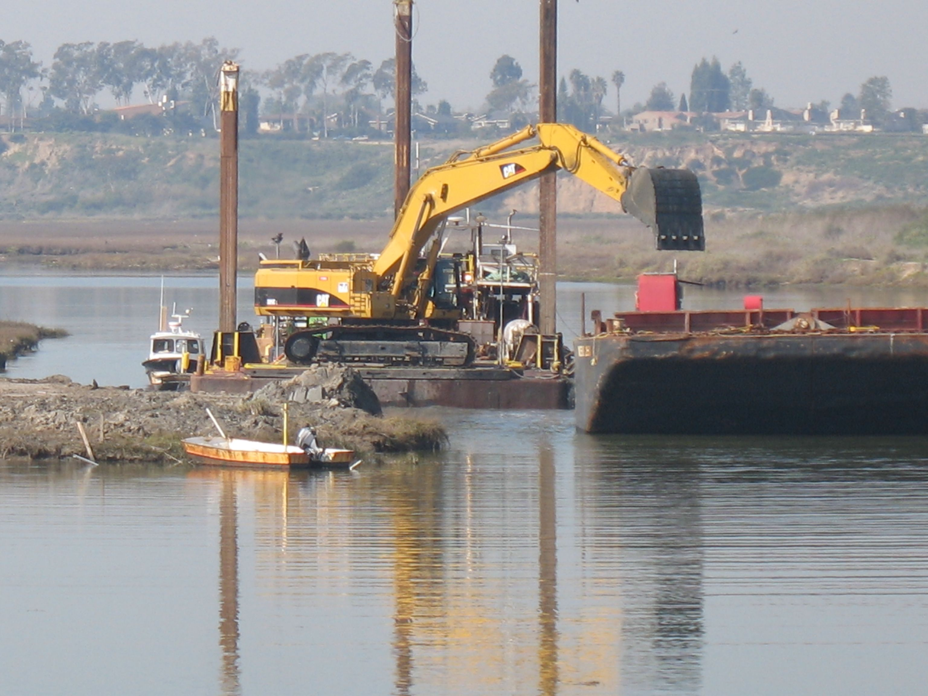 Dredging with a 385 in the Back Bay of Newport Beach, CA 2010