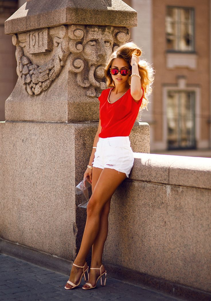 Red shirt, white shorts, and high-heeled sandals
