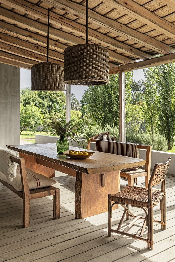 Outdoor: Gorgeous Outdoor Rooms to inspire Summer Entertaining. Rustic Veranda. A home in Garzón, a quaint village near the southeastern coast of Uruguay, features rustic accents, including a pair of pendants and a dining table made of Brazilian wood. #bushcraft #design #beautiful #lifestyle #instagram #wandern