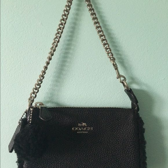 Small black Coach purse Coach black, leather mini purse with black fuzzy lining around it and a fuzzy ball!! Worn one- brand new condition. Coach Bags Mini Bags