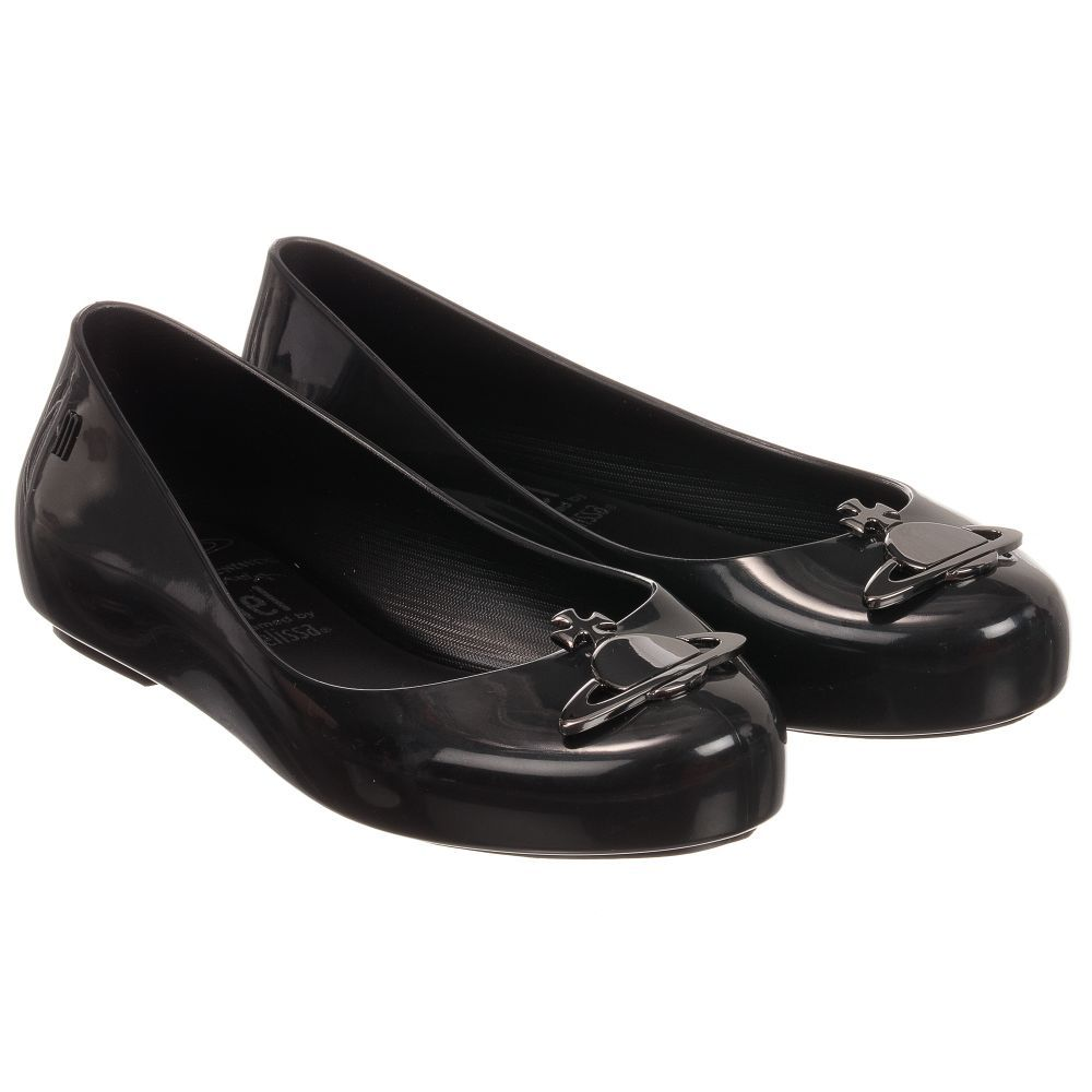 A black shiny pair of jelly pumps for