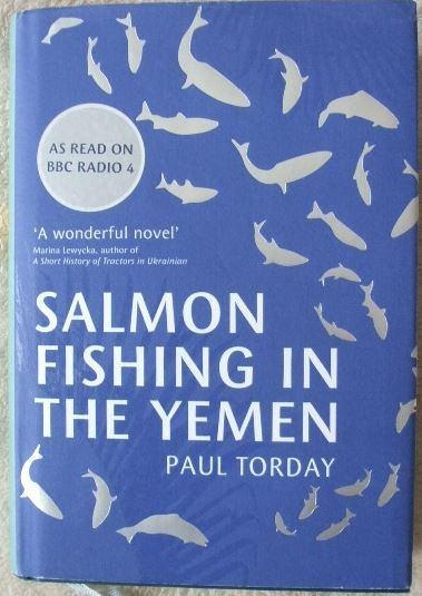 Salmon Fishing in the Yemen by Paul Torday. This is the story of Dr Alfred Jones, a fisheries scientist - for whom diary-notable events include the acquisition of a new electric toothbrush and getting his article on caddis fly larvae published in 'Trout and Salmon' - who finds himself reluctantly involved in a project to bring salmon fishing to the Highlands of the Yemen - a project that will change his life, and the course of British political history for ever.
