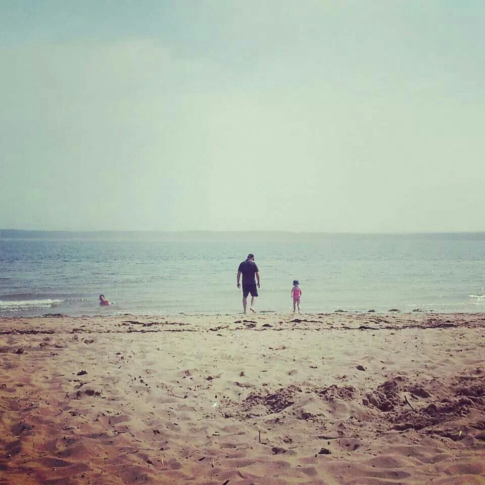 Daddy & His little girl dipping their toes in the sea.