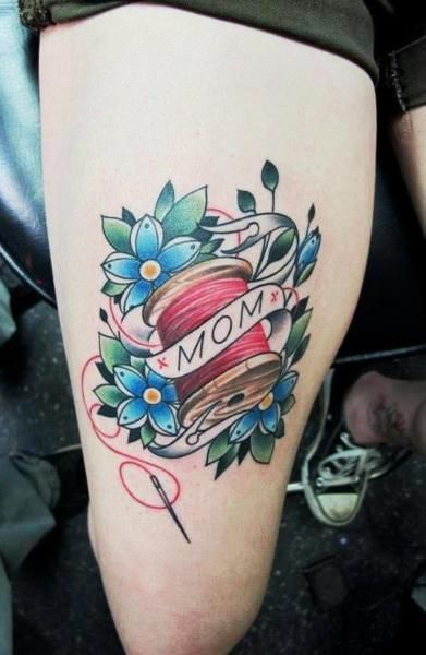 Cute! - not mine - I got this on my right thigh for my mom who loves to sew. Its done by Terry Grow at AAA tattoo in Lafayette, Louisiana. Terry is with out a doubt one of the best tattoo artist ive seen/ come across. Beautiful clean colorful lines with amazing detail, & he does traditional style (my favorite) better than most artist ive seen out there.