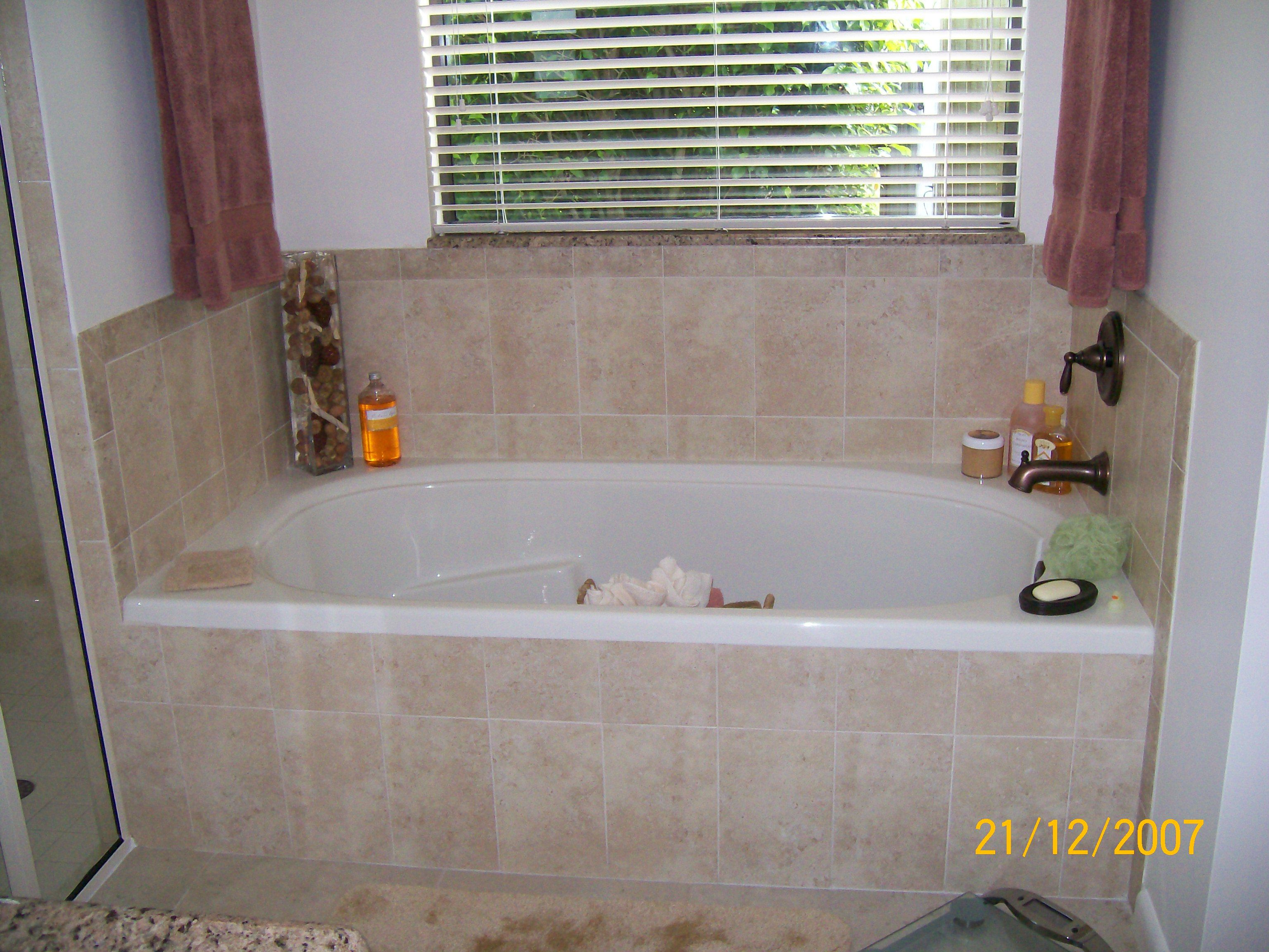 Acrylic Soaking Tub with Ceramic Tile Backsplash & Tub Skirt