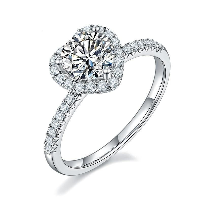 Dazzling and chic, this eye-catching 925 Sterling Silver 1Ct VVS1 Moissanite Diamond Heart Promise Engagement Ring is the perfect jewelry accessory to complete your look. This ring will always give you a great look and you will always be on-trend with this timeless classic. This stunning Moissanite ring is a piece of jewel that will certainly amaze you, and is suitable for all occassions. Complete your jewlery collection with this gorgeous promise ring and get exactly what you need! Mix and matc