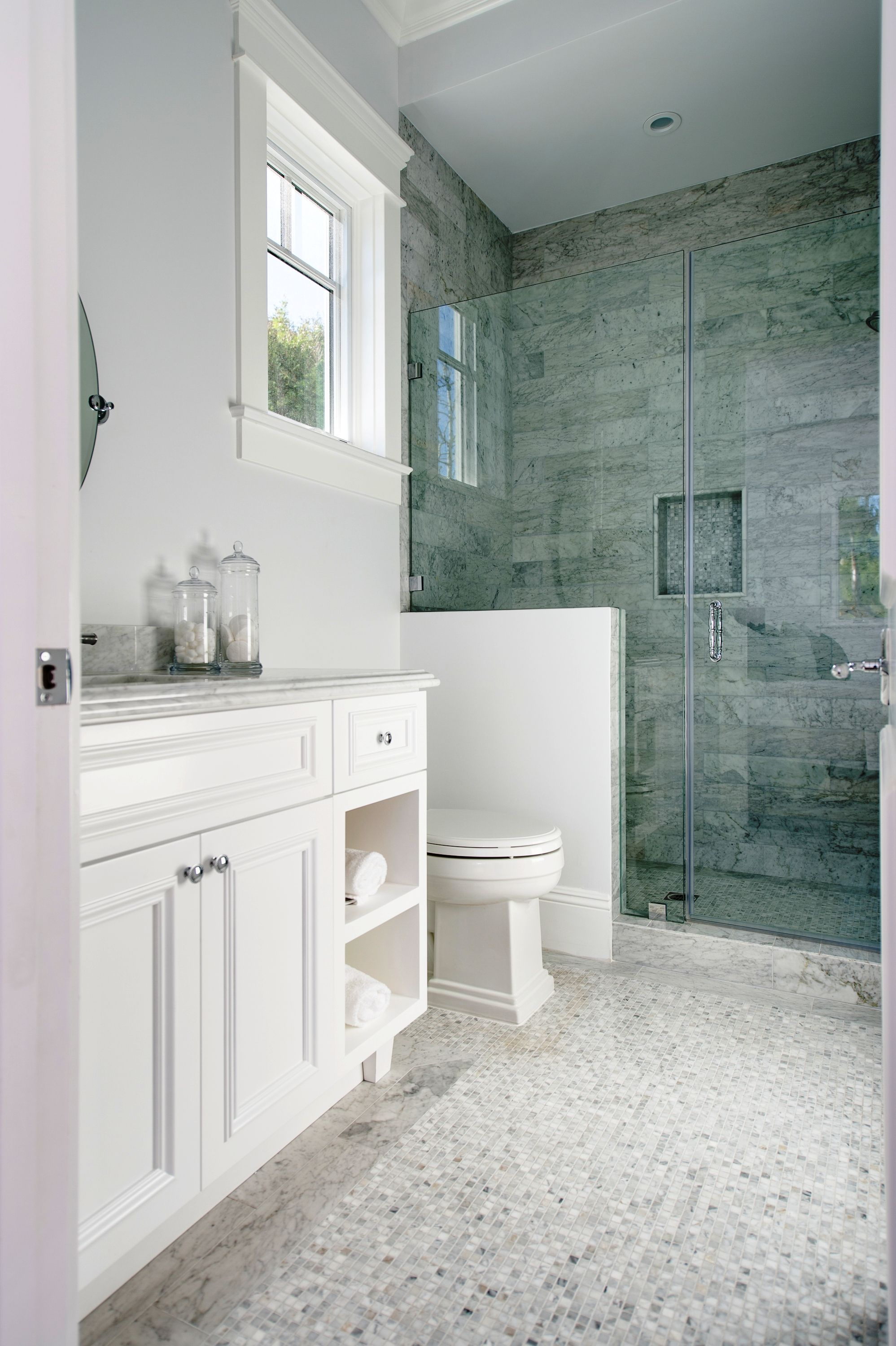 shaker style cabinets cape cod style bathroom at densmore in los angeles by boswell construction