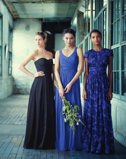 Bridesmaids wear dresses in similar hues