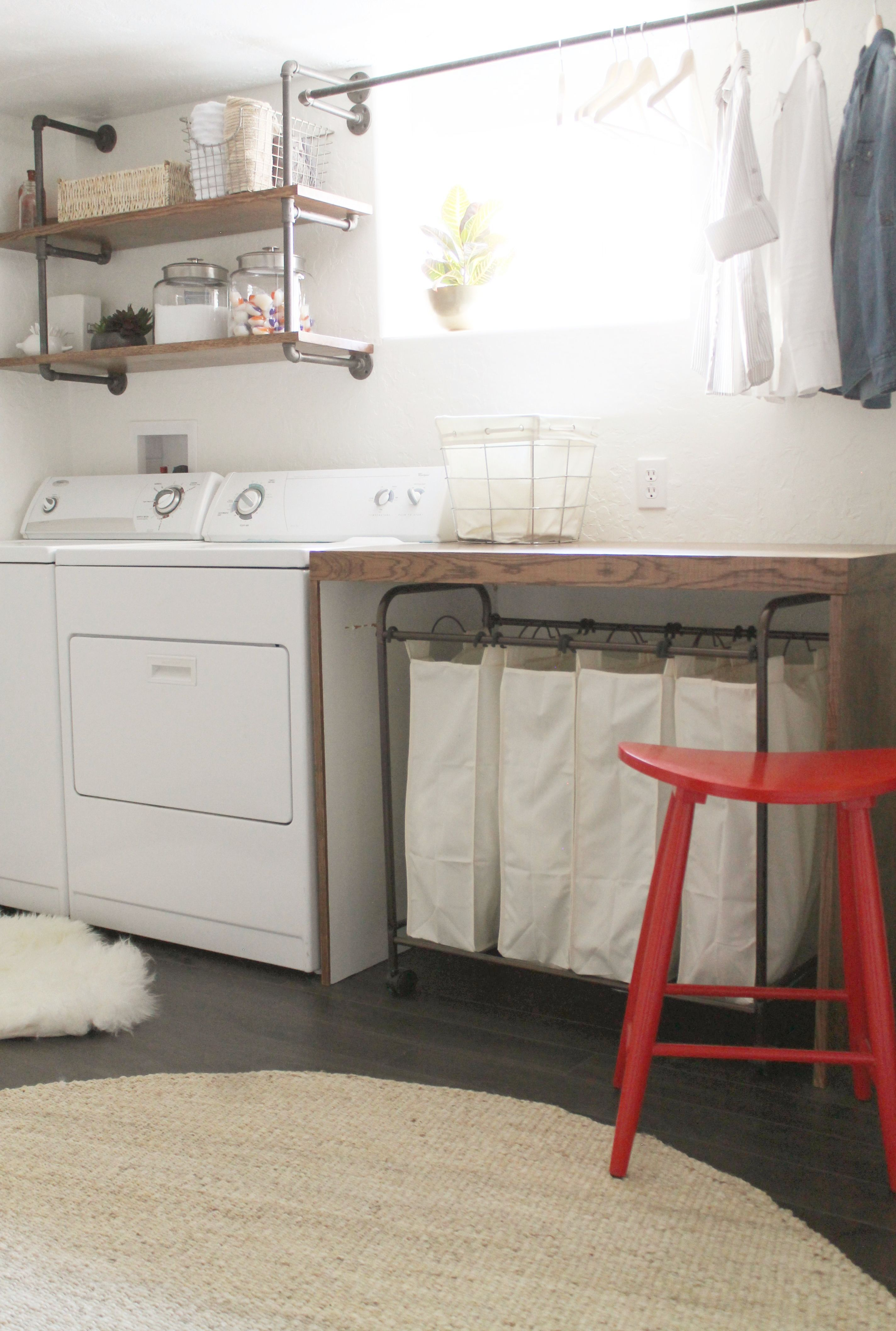 Basement laundry room i like the simplicity of this room the wooden folding table