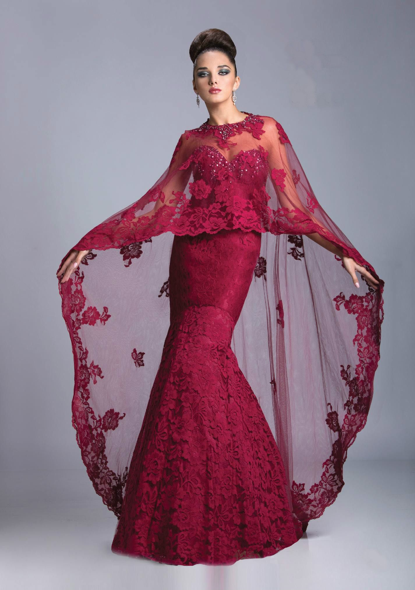 Cape With Embroidered Flower Pattern Adds Dramatic Flair To Strapless Gown Dress Has Sweetheart Neckline With E Gowns Designer Evening Dresses Evening Dresses