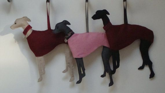 Whippet / Greyhound Decoration, wearing a red coat, martingale style collar, made with love dog tag. Modelled on a real Whippet. Handmade, cut from felt, head is filled to create a 3 dimensional decoration. Size - large.    This is not a toy & is not suitable for children. © All rights reserved 2012
