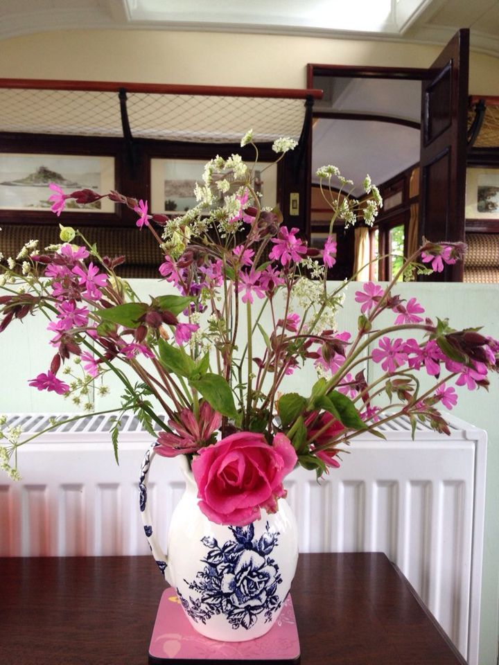 A vase of flowers on the 27th May. The first of the #roses are out.