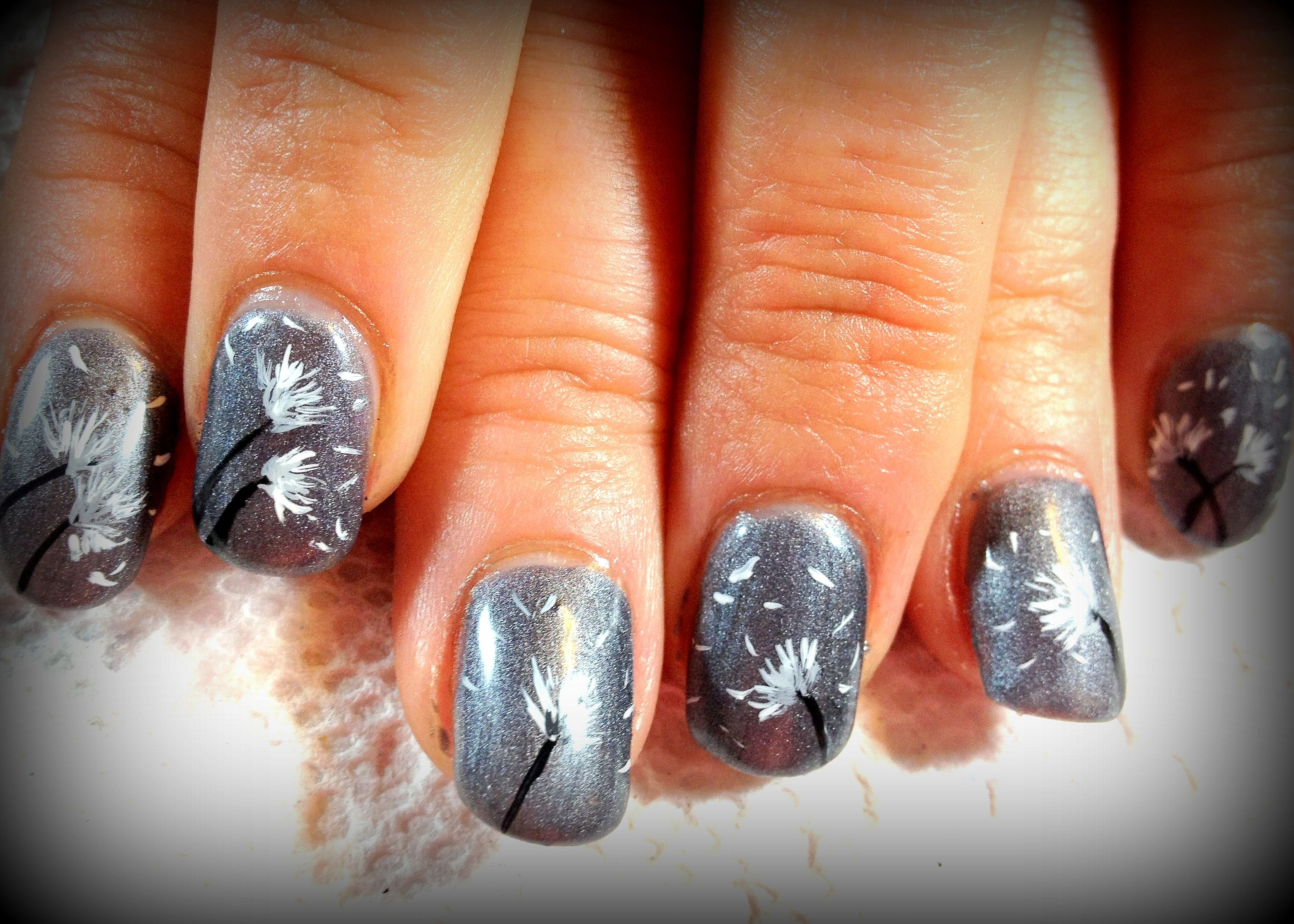 My Dandelion blowing puffs manicure LOVE them ... done by Nailz Ink