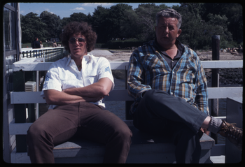 Two men seated on a bench, 1972