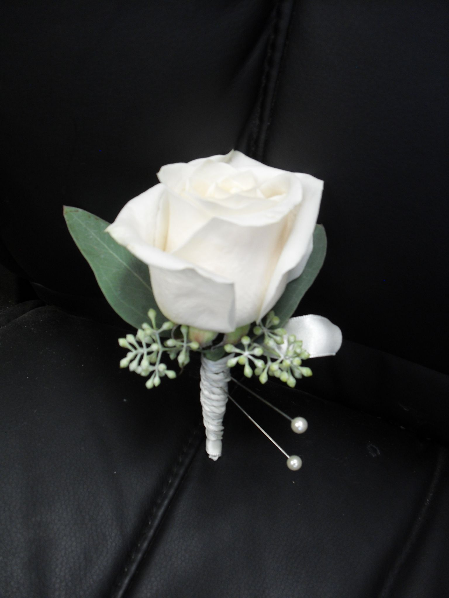 white rose boutonniere for wedding and prom