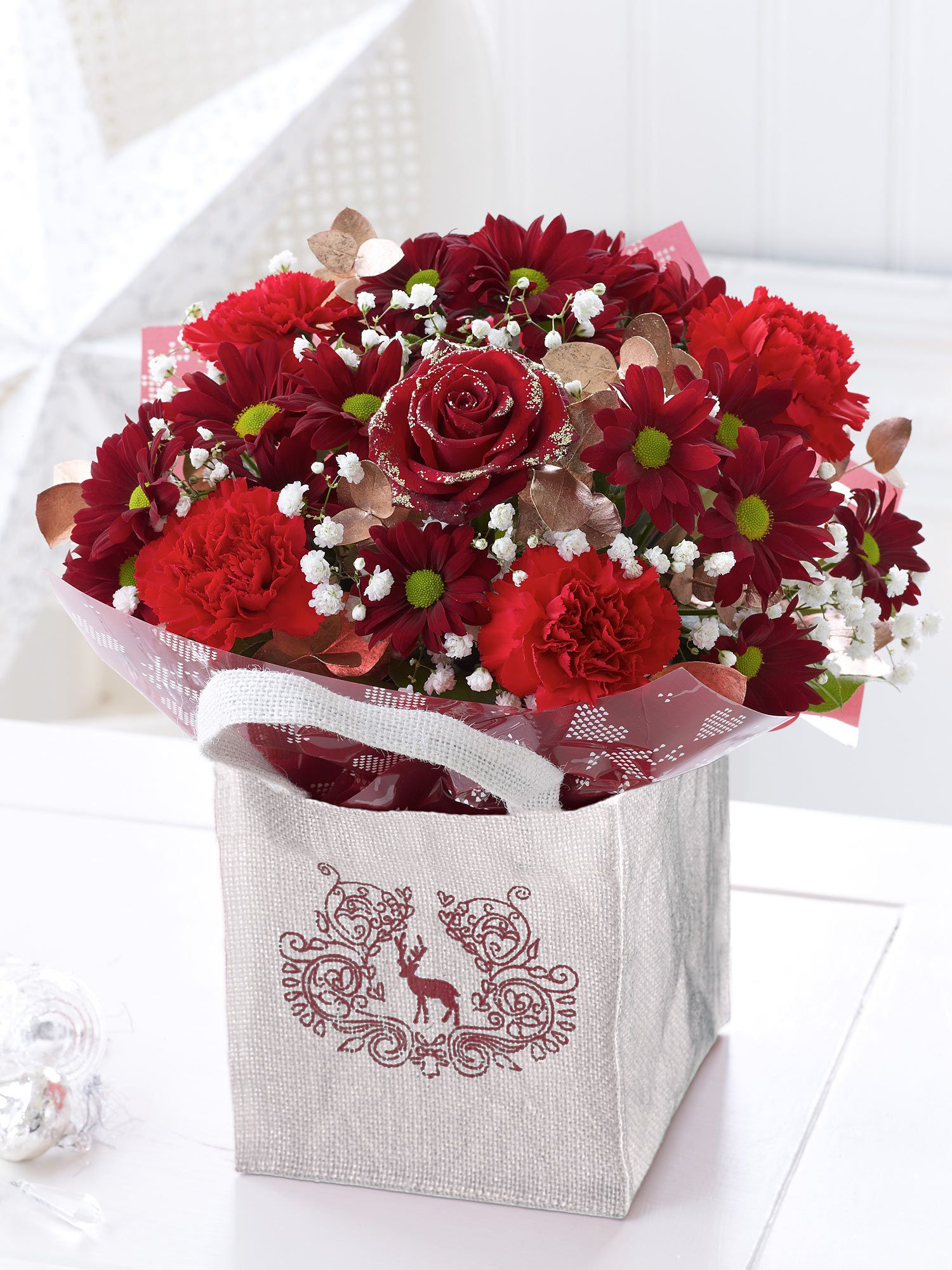 Christmas Gift Bag With Chocolates  Interflora Rose Sprinkled With