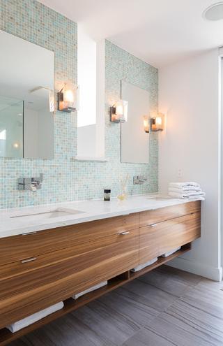 Bathroom - Full mosaic tile wall behind sinks.  Light blue / Sea green tile.