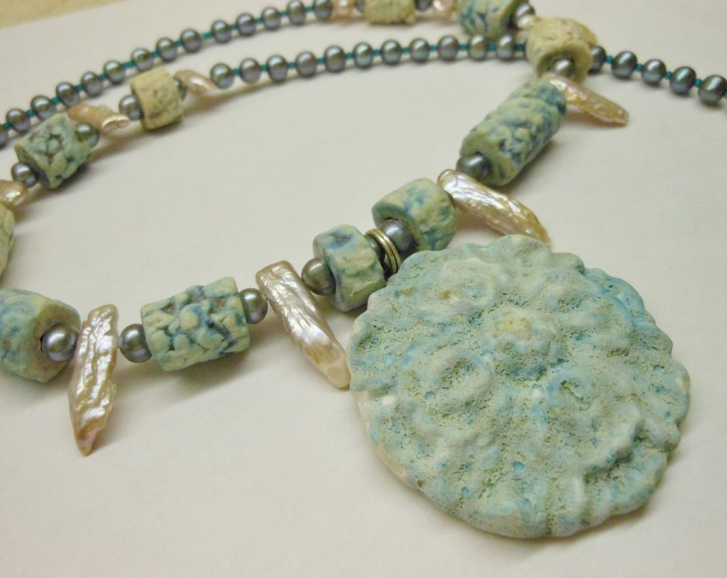 by Sheri Mallery I made ceramic necklace with a salt glaze.