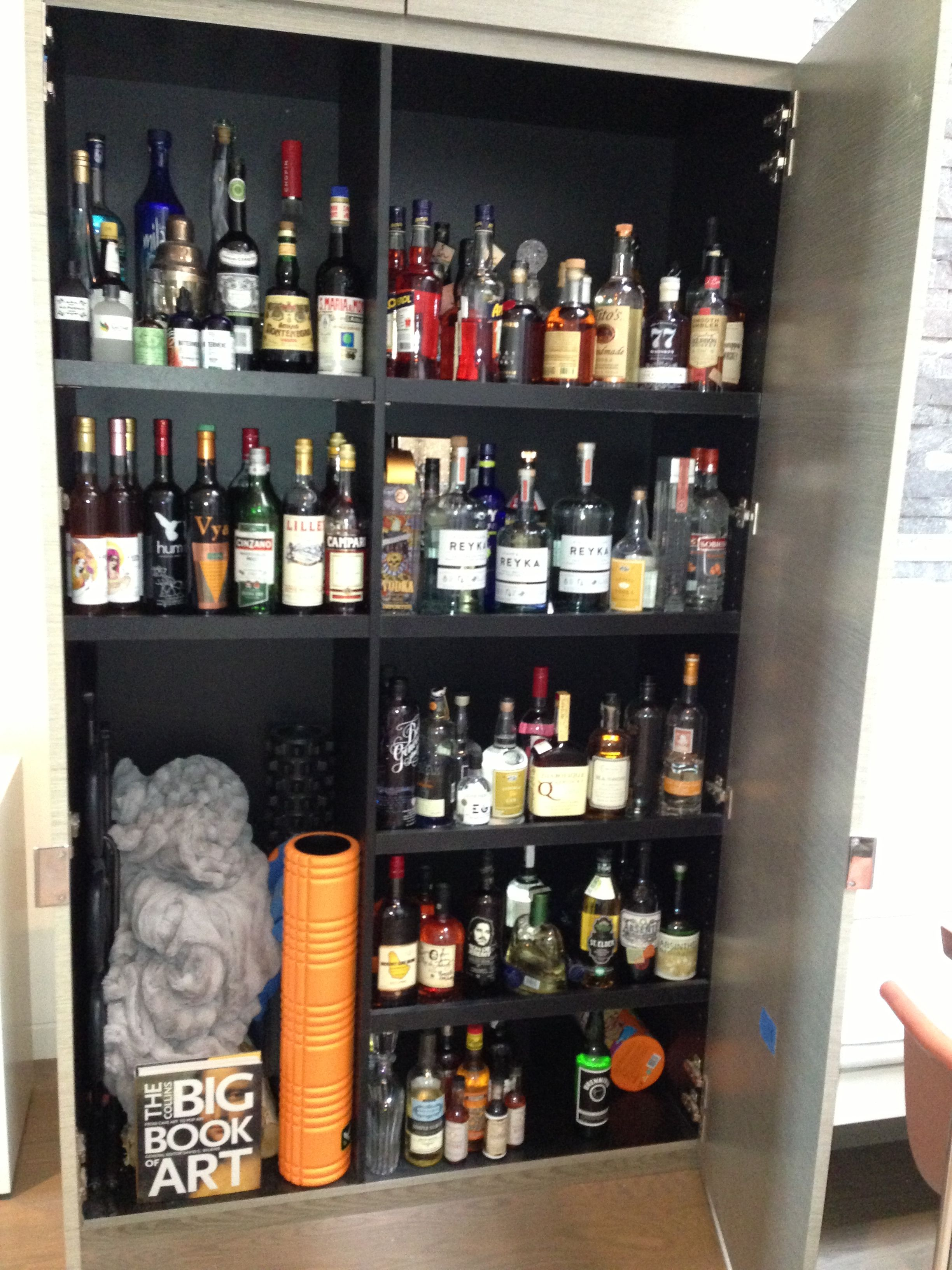 Hidden wall liquor kitchen island storage