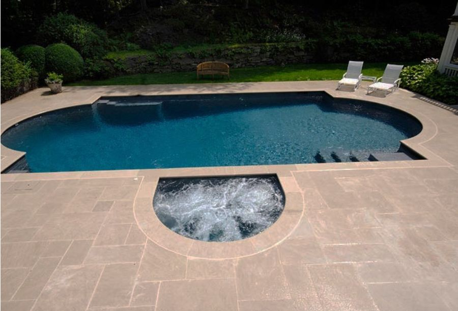 Grey coping pools pool area tumbled travertine pool for Pool area tiles