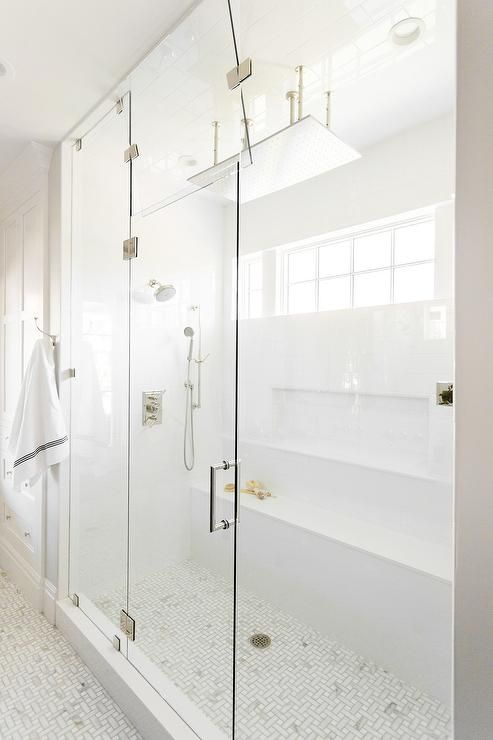 Gorgeous Long Steam Shower Is Ed With A Seamless Gl Enclosure And Marble Maze Floor Tiles
