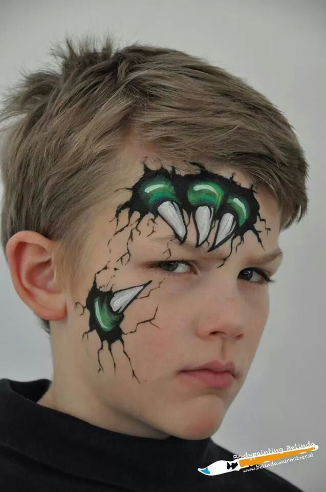 "Very cool ""claw coming through the face"" face painting for ..."