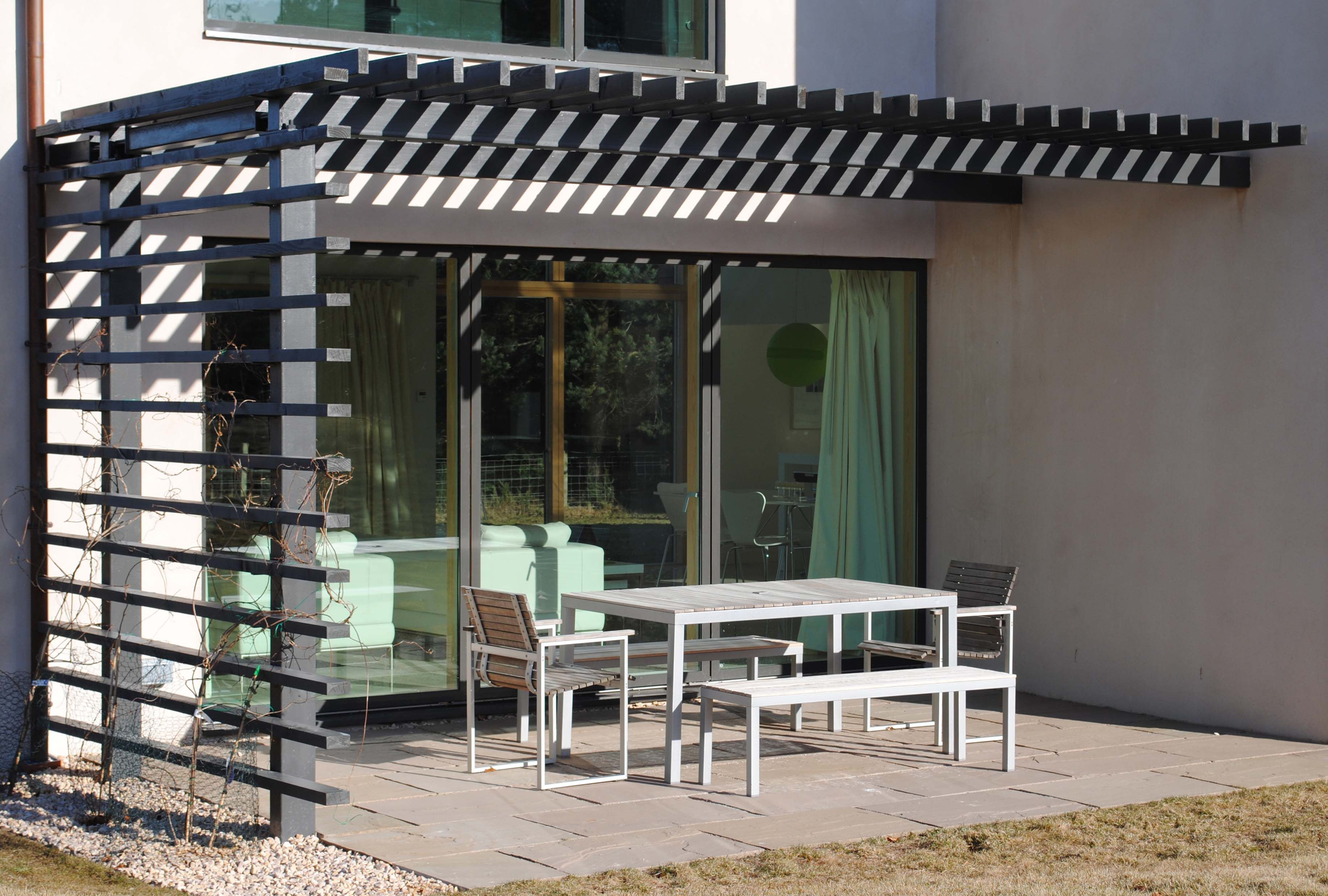 Steel and timber pergola. add retractable canvas roof