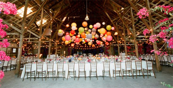 Ok, I will admit it, paper lanterns are NOT my favorite item to use in decorating.  However, I love the way these colorful lanterns look in this cavernous space!  They add color and texture... and bring that massive ceiling down to human proportions.  Well done!!!
