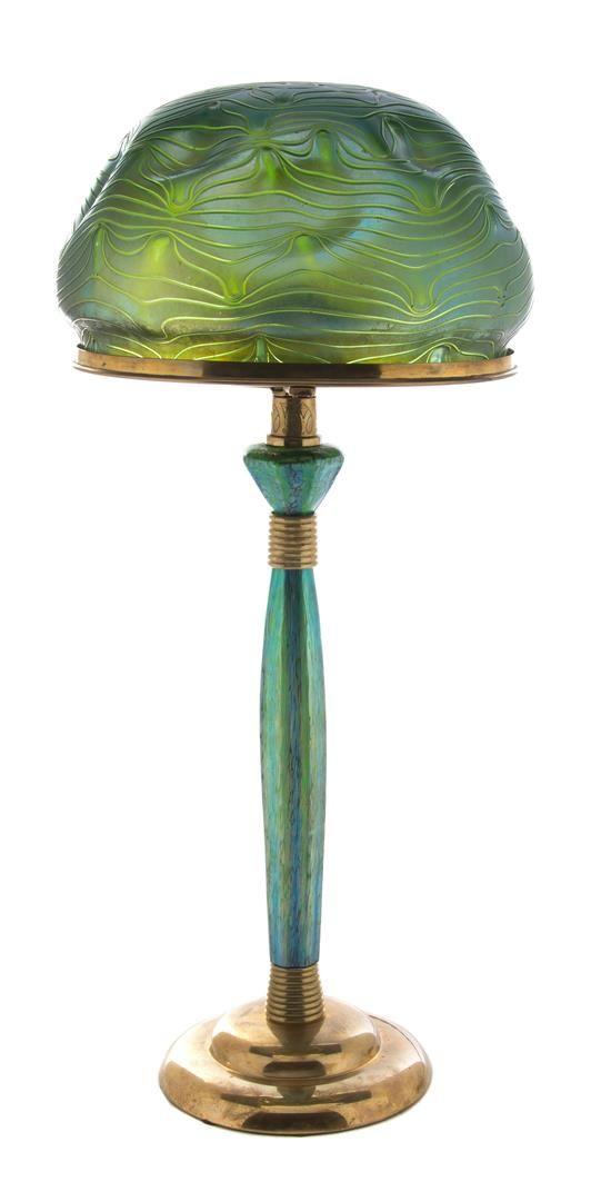 An austrian art nouveau loetz glass and gilt metal mounted lamp designed b