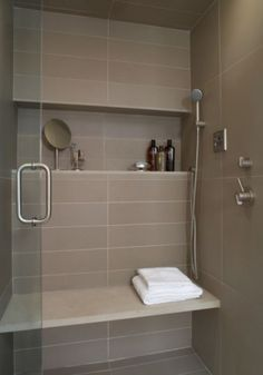 The perfect shower, built in bench seat with a great shelf above and a hand held shower head. Make it a walk- in shower and you have a deal?!