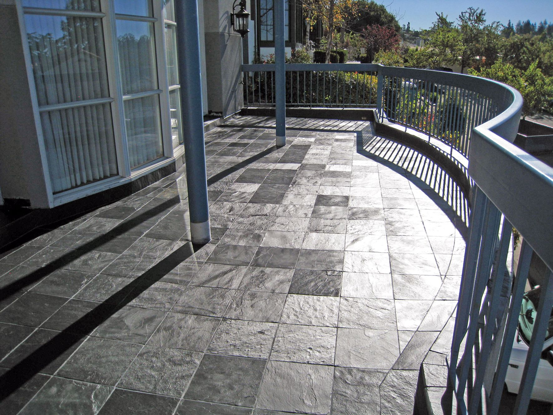 Silver blue slate exterior pinterest exterior tiles installing a tile walking deck brady roofing dailygadgetfo Choice Image