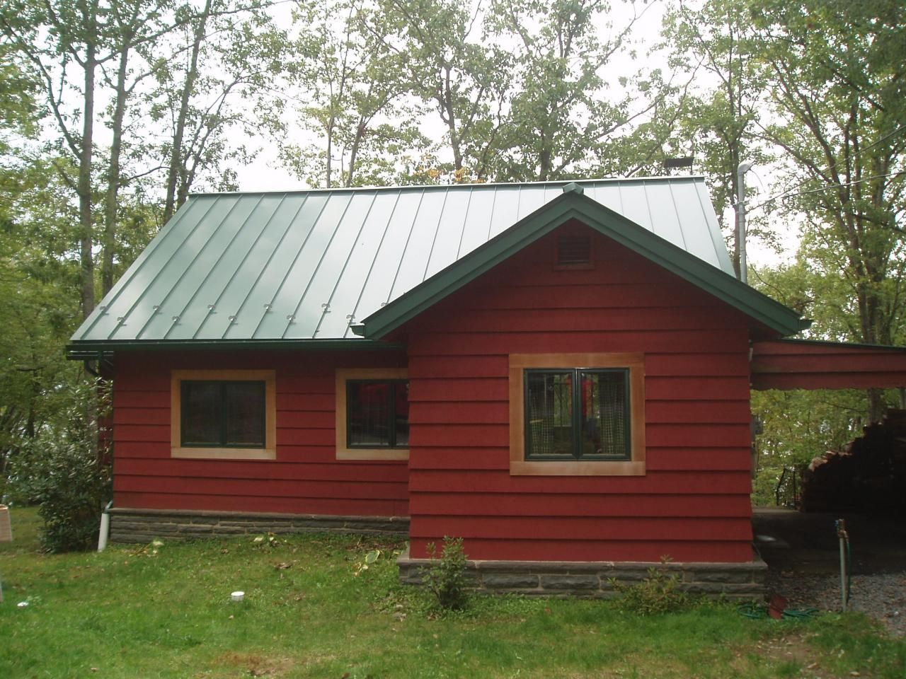 Green metal roof house google search house exterior for Metal building cabin