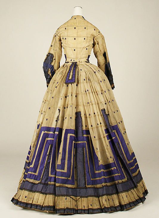 A dress from the Metropolitan Museum of Art, circa 1863. Love the unexpected color combination and the graphic quality of the decoration.