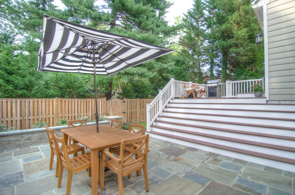 Bethesda Patio and Deck project - Flagstone patio and Fiberon deck.  Creative use of small space. Design and project done by The Sharper Cut Landscapes (sharpercut.com). Photo credit: Mark Petinga Photography