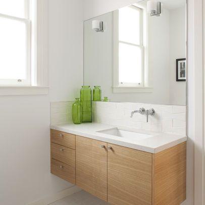 Clean And Simple Vanity With Offset Sink High Backsplash 2
