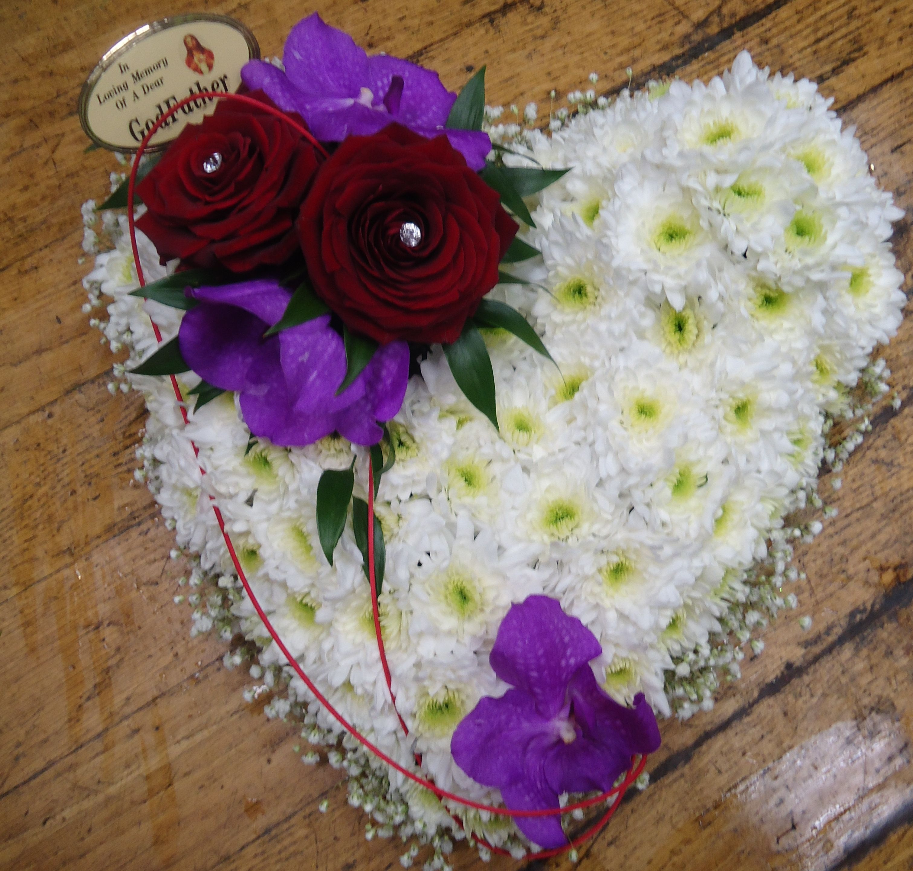White based heart with vanda orchid and grandprix roses funeral