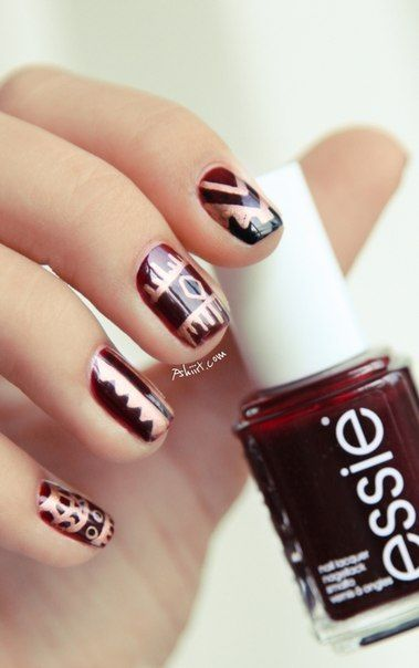 gold and oxblood tribal nails