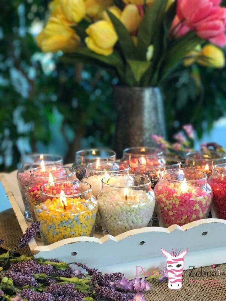 Beautiful diy glimmer candles using pink zebra sprinkles