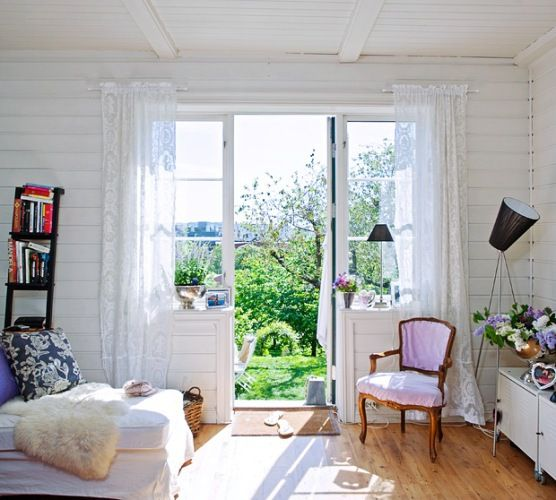 I love the door flanked by those windows!