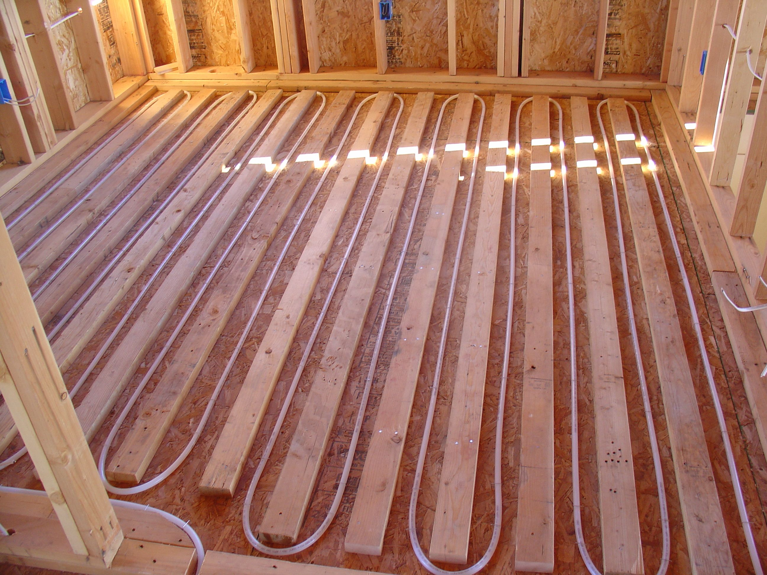 Wood Sleepers Nailed Dow To Give The Hardwood Floor Installer Something To Nail To Radiant Floor Heating Building A Container Home Heating And Plumbing