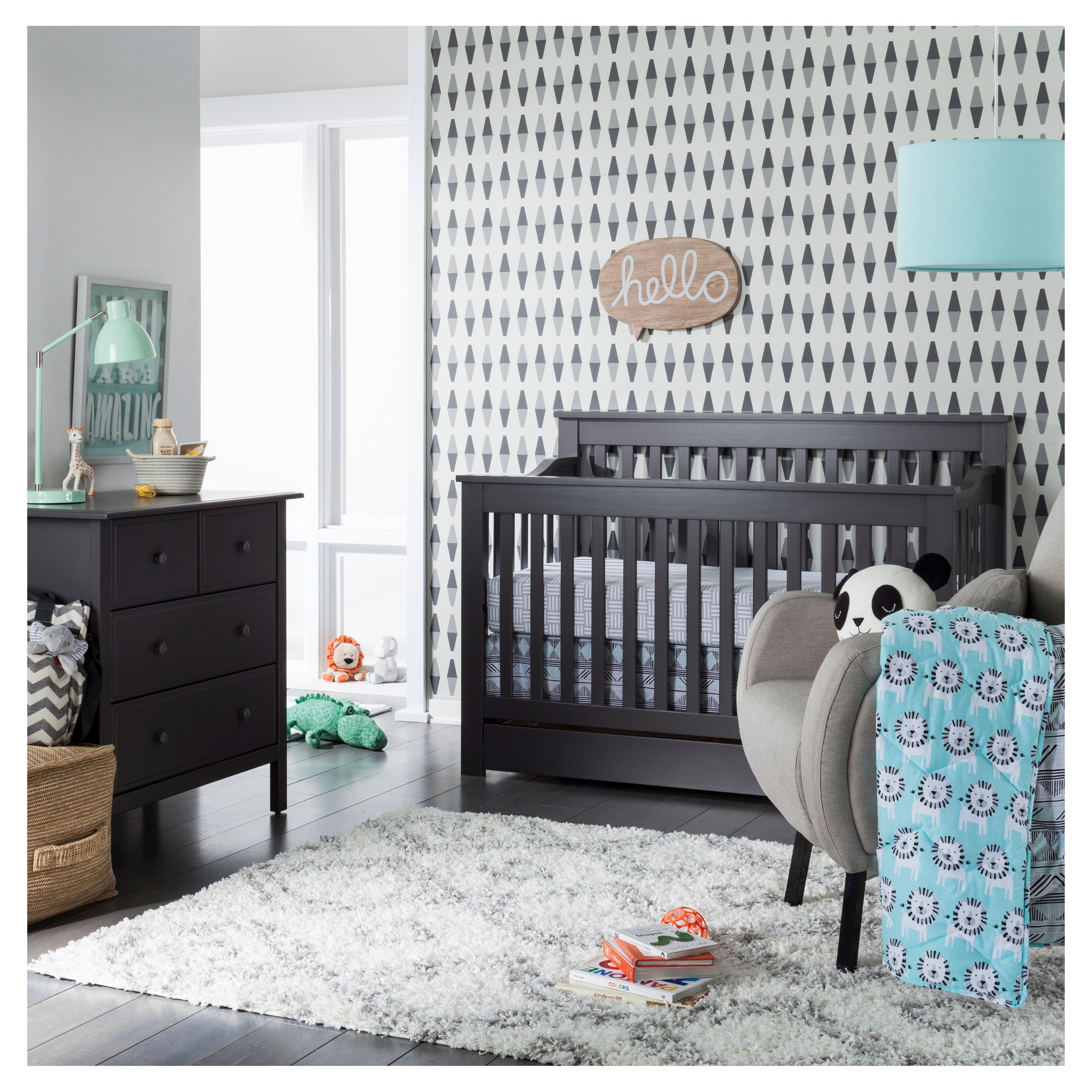 Your little love will roar with delight for the Sabrina Soto Leo Collection. Playful lions in grey, black, and white pop against a cheery turquoise background instantly creating a space full of life and bright energy! The reversible comforter features a grey, black, and white Aztec-inspired print with hints of turquoise. Made from 100% cotton, this soft and comfy 3-piece crib set includes a quilted comforter, fitted crib sheet, and crib skirt. Complete your look with baby blankets, changing…