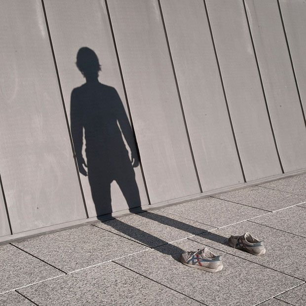 Photos of Empty Shoes with Shadows and Reflections   Plays, The o ...