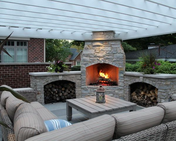 Comfortable corner outdoor patio with custom fireplace Outdoor fireplace design ideas
