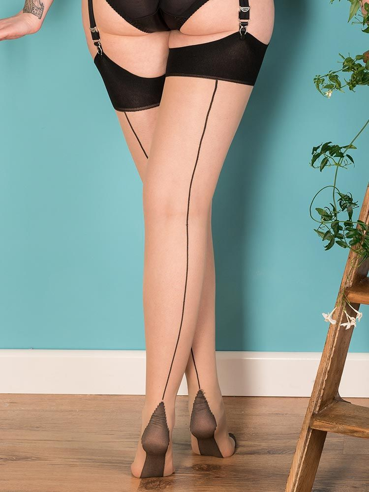 4355046e1ba451 Striking Contrast Seamed Stockings featuring a sharp black seam on a  neutral champagne coloured leg. A flamboyant accessory to a 1950s outfit.