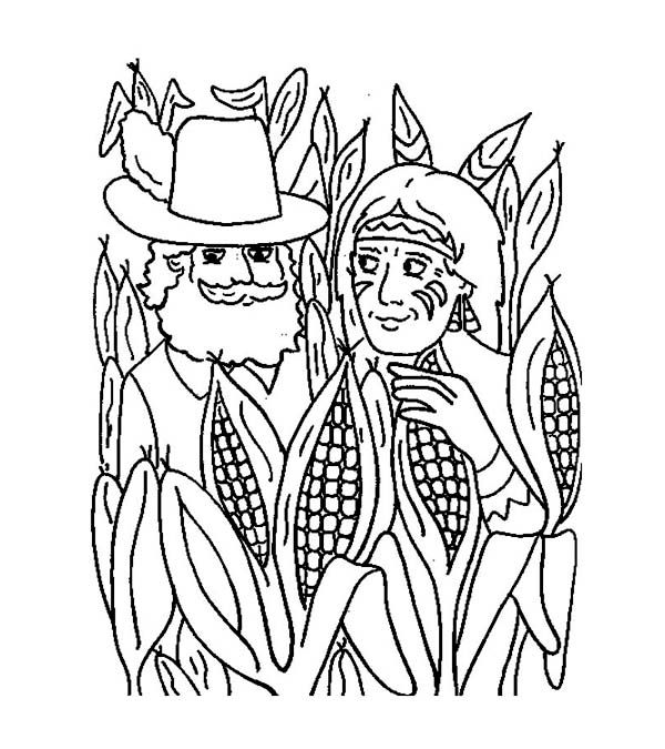 Native American And Pilgrim In Corn Field During Thanksgiving Day