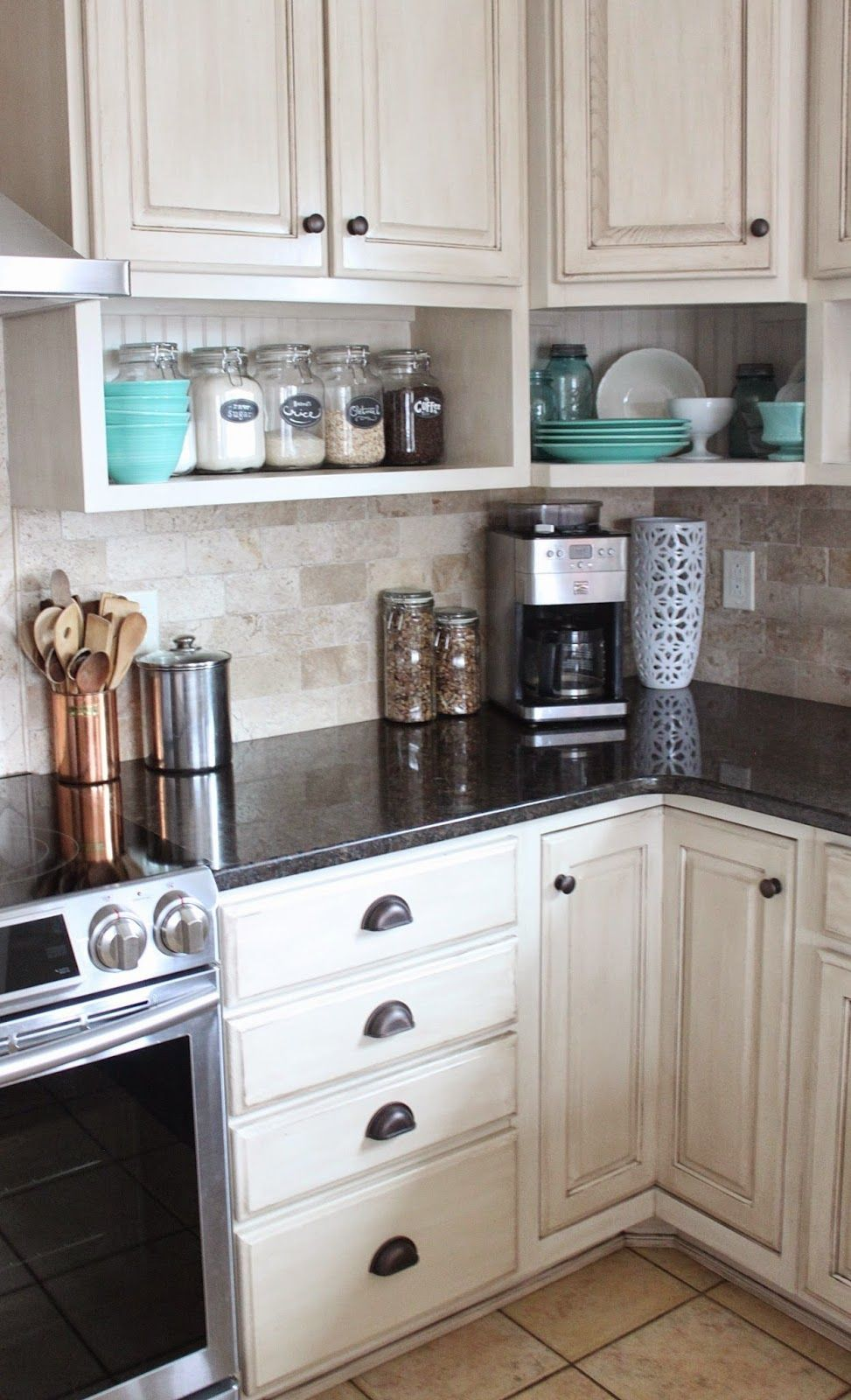 Raised wall cabinets with shelves built underneath. Namely ...