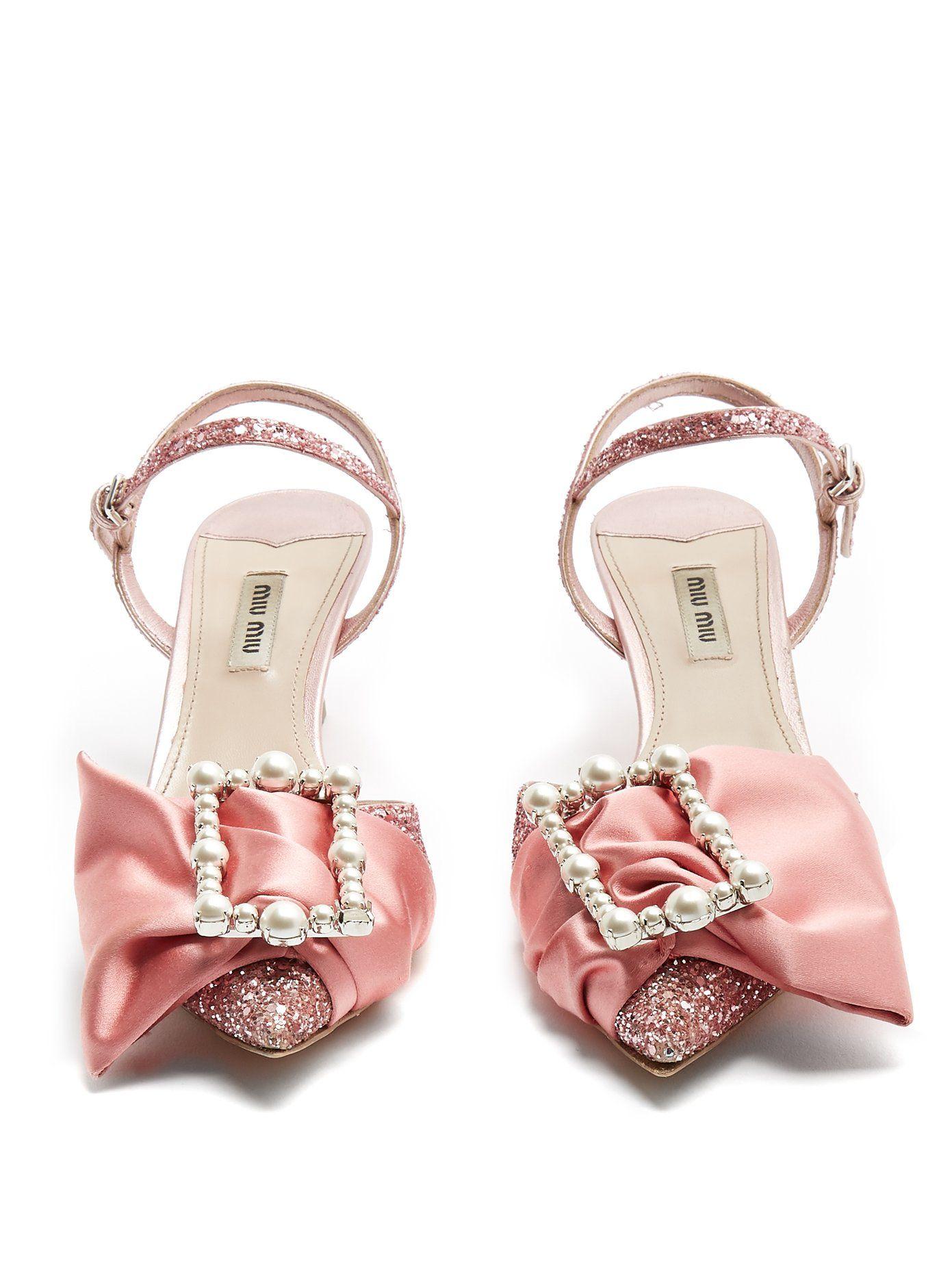 51e930c7b81 Click here to buy Miu Miu Bow-embellished glitter pumps at  MATCHESFASHION.COM