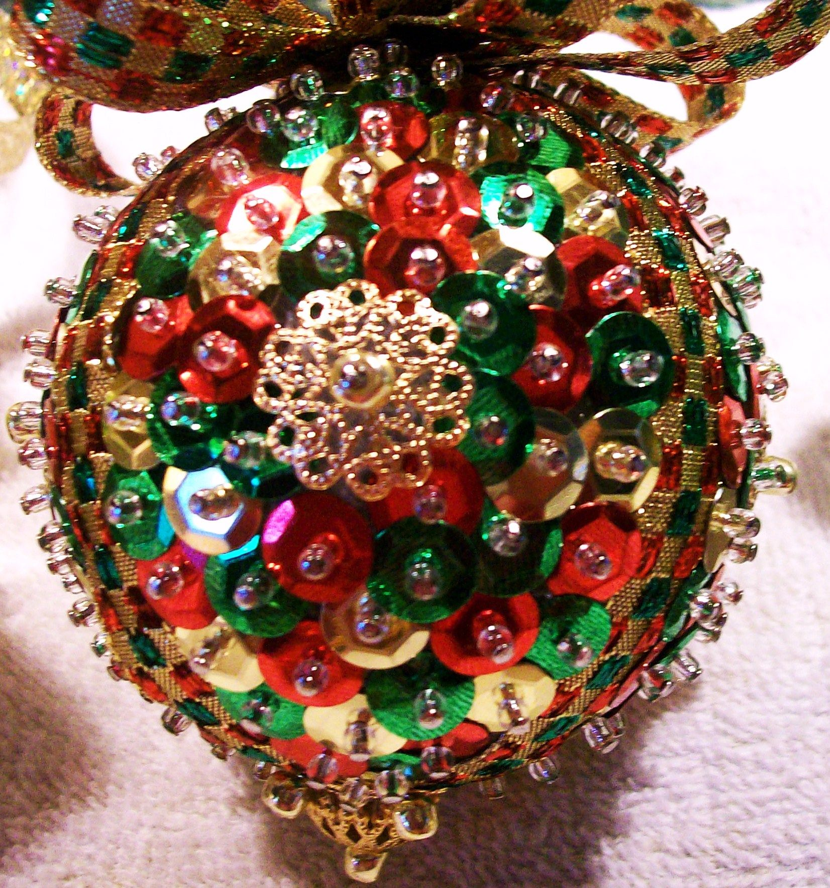 styrofoam balls, sequins, straight pin, beads, ribbon