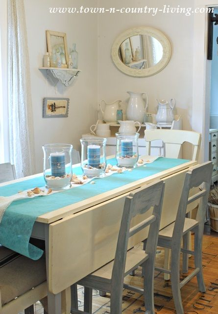 How To Create A Summer Coastal Centerpiece Town Country Living Christmas Dining Room Table Dining Room Table Christmas Dining Room