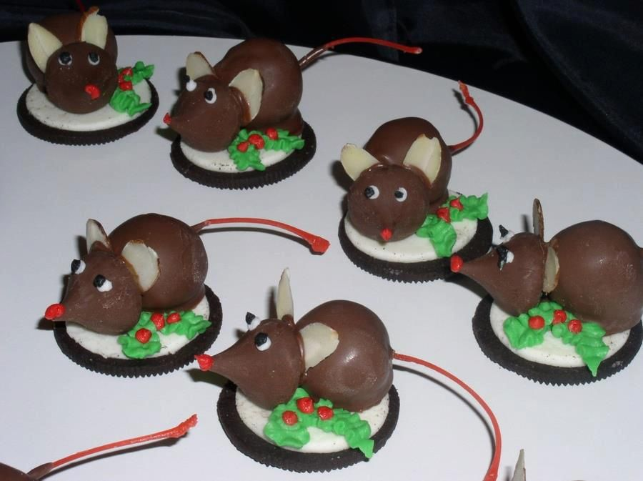Cute Christmas Mice!  Open face up Oreo cookie  Chocolate dipped cherry for the body  Hershey's Kiss for the head   The rest is done with icing (using a very small tip)